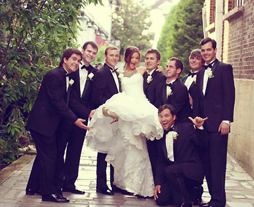 Bride and groom with groomsmen in tuxedos